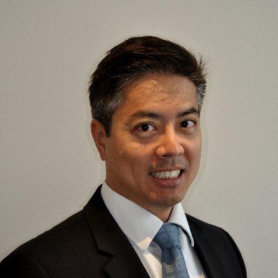 Headshot of Dr. Adam Tan DMD FAGD AIAOMT, CEO of Georgian Dental