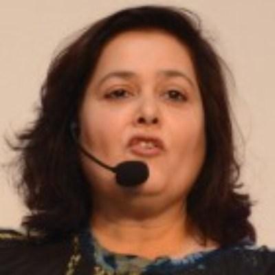 Headshot of Urrshila Kerkar, CEO of Cox & Kings