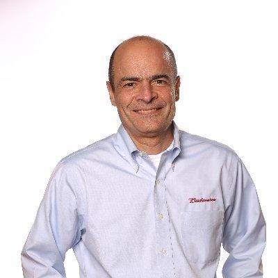 Headshot of Carlos Brito, CEO of Anheuser-Busch InBev