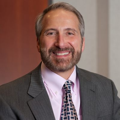 Picture of Dr. Jason Providakes, CEO of Mitre Corporation