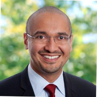 Headshot of Francis deSouza, CEO of Illumina