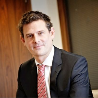 Headshot of David Arnott, CEO of TEMENOS