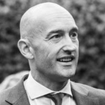 Headshot of Guy Hayward, CEO of Goodman Masson