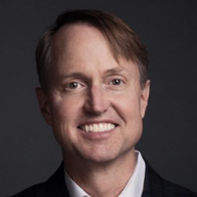 Headshot of Greg Hughes, CEO of Veritas