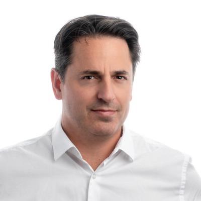 Picture of Ian Hodge, CEO of TRICOM BUILDING MAINTENANCE LTD.