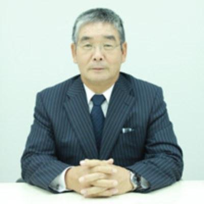 アスカグループの経営者加藤 秀明氏の顔写真