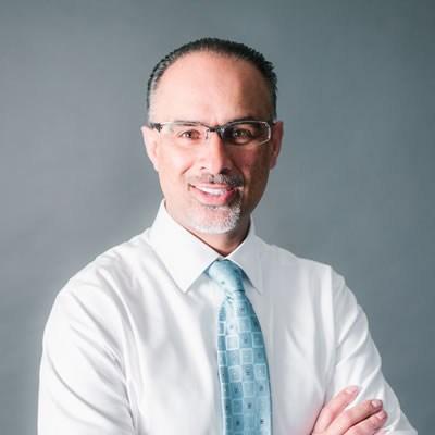 Headshot of Amin Shivji, CEO of 123Dentist