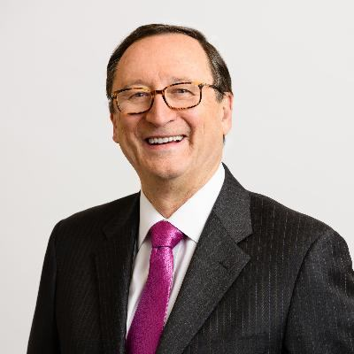 Headshot of John Haley, CEO of Willis Towers Watson