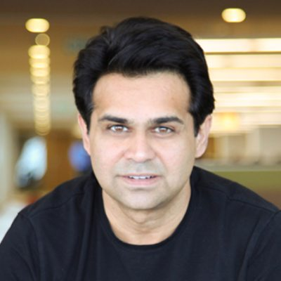 Headshot of Faisal Husain, CEO of Synechron
