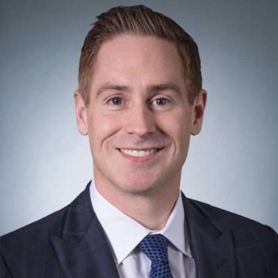 Headshot of Kurt MacAlpine, CEO of CI Financial