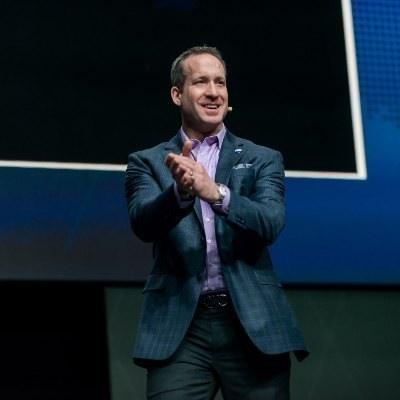 Picture of Adam Contos, CEO of RE/MAX