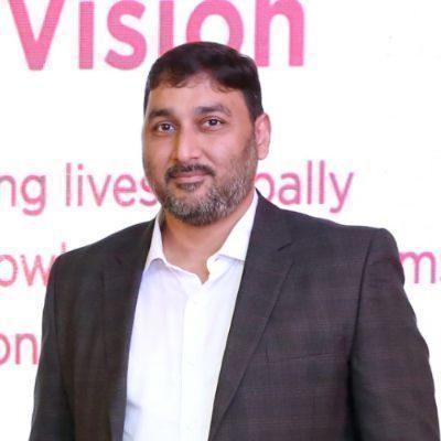Headshot of Ashish Tibdewal, CEO of Vibgyor High
