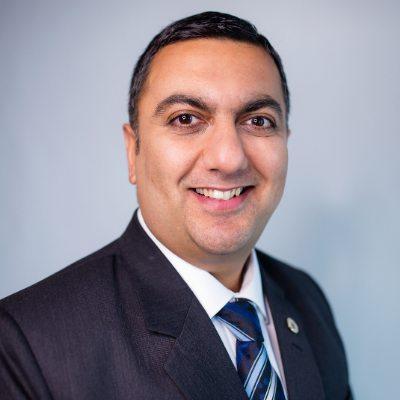 Headshot of Rish Malhotra, CEO of International Road Dynamics Inc