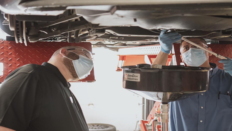 Teammates working under a car