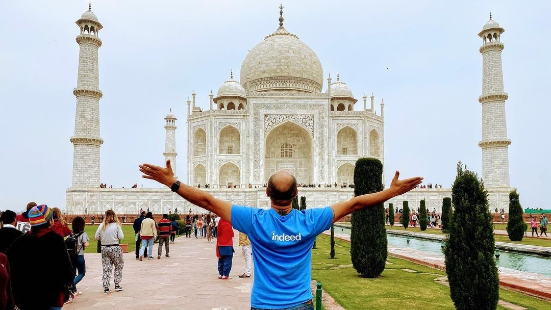 Indeedian poses in front of Taj Mahal in India