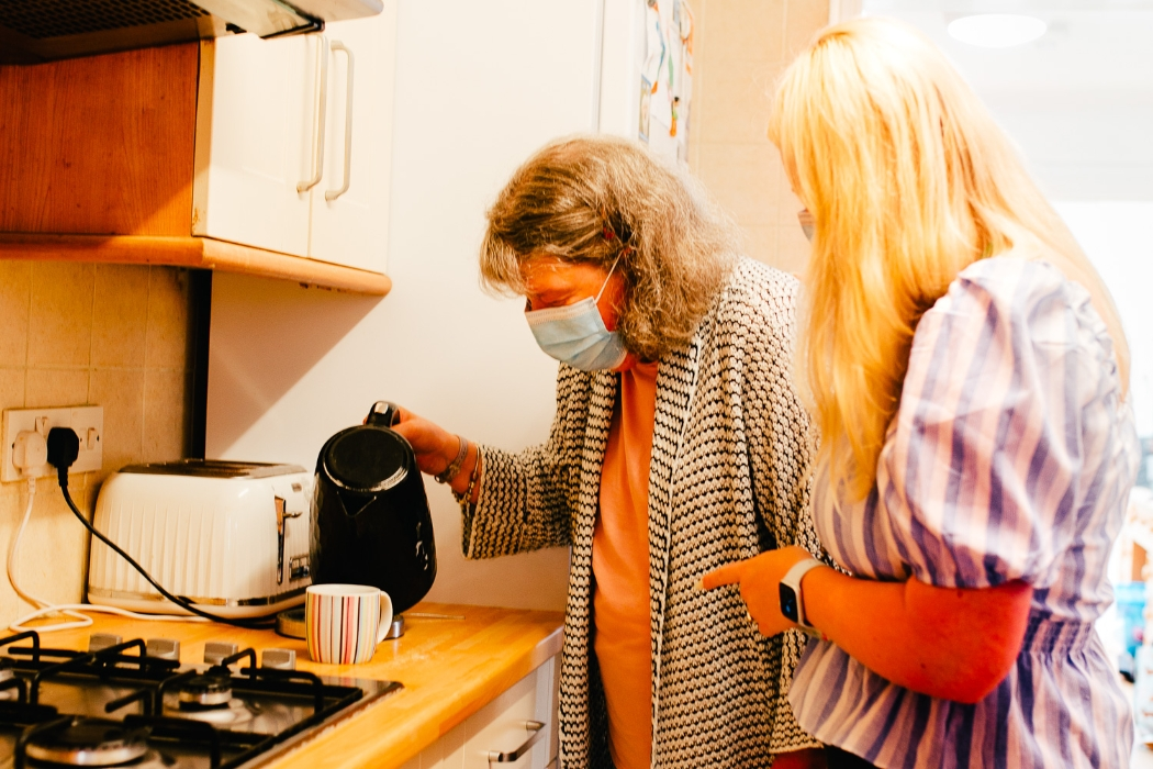 Aspens Staff supporting a woman in her home to make a cup of tea