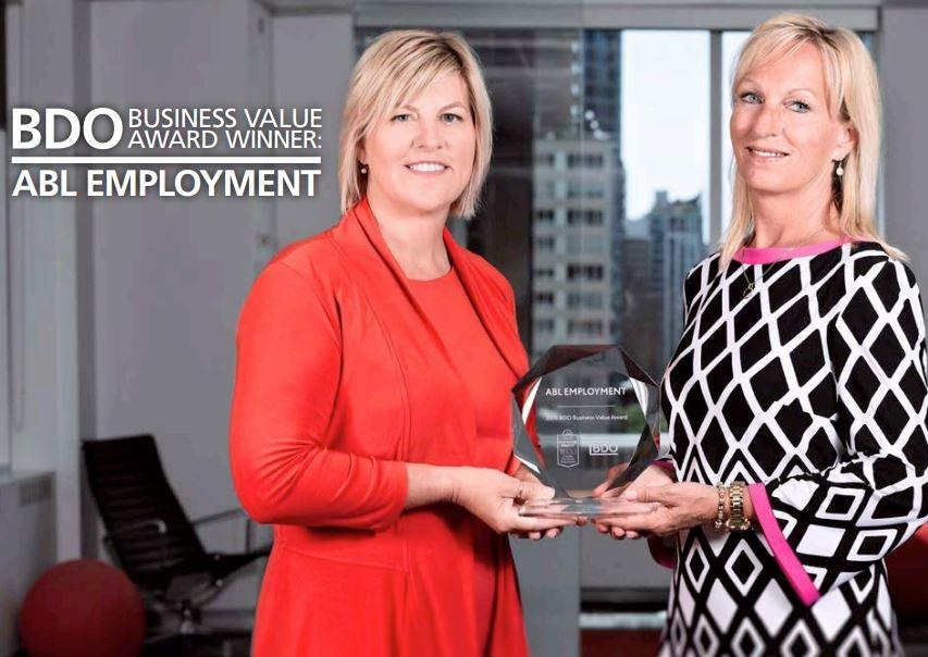 Our Founders, PJ Ferguson and Jill Dee Ferguson, holding their BDO Award.