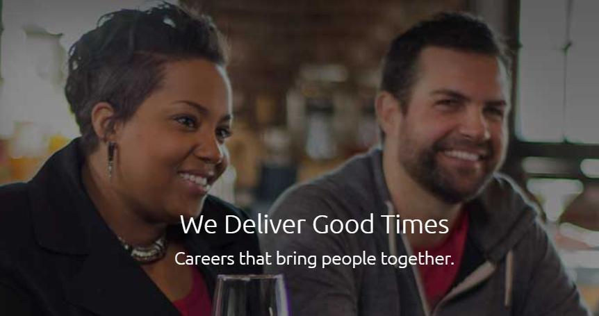 """an African American woman and a white male sitting together with caption """"We Deliver Good Times"""""""