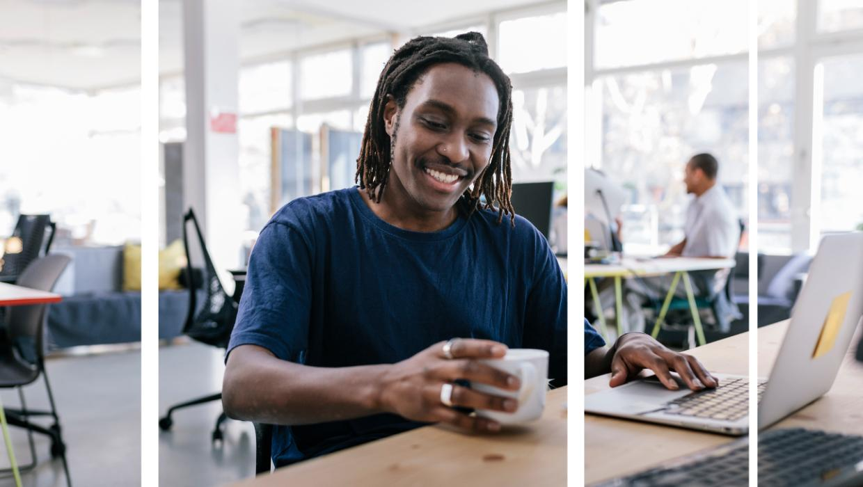 Young man working social distanced in office