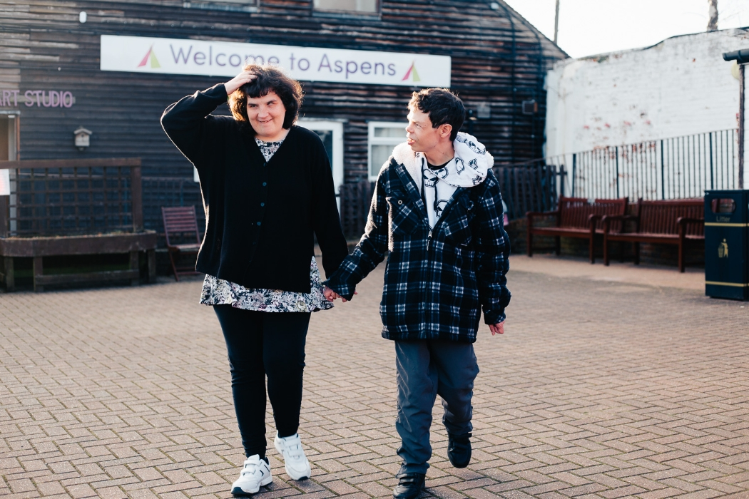 two service users walking hand in hand at our offices in Pembury