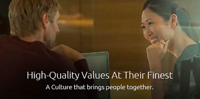 """White male and Asian woman sitting with caption """"High Quality Values at their Finest"""""""