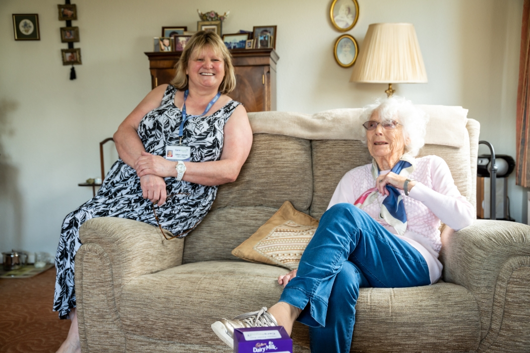 live-in carer smiling with her elderly client