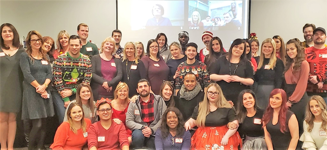 ABL Team photo from our year end holiday party in 2019. Our BC team is onscreen in the background.