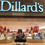 Dillard's, Inc. photo: Mall entrance caption showcasing baskets from scentsational event