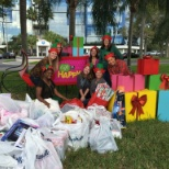 Merchandising team collecting Holiday donations for HSN Cares