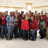 Volunteering with Lowe's and Fox 8 gifts for kids.