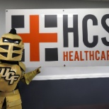 HCS Healthcare photo: University of Central Florida's mascot, Knightro, stopped by our office for our Go Gold Event