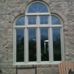 MERRELL HOME IMPROVEMENT photo: 9 in 1 window with 1 piece round top facing and keystone accent