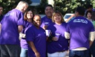 Cyberonics' CEO and employees wearing their purple shirts for Epilepsy Awareness Month.