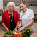 Support worker assisting client with meal preparation