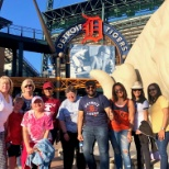 Home-based employees in Michigan meet up for a Detroit Tigers baseball game.