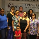 Staff and resident after providing a glowing testimonial to the care at Parkville.