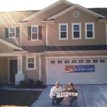 Signtronix.com photo: The Hall Family with their new house - because of their success with Signtronix.