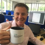 HPE UK& I employee having coffee in the office