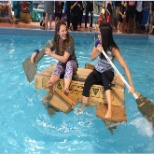 Team-building fun at the 2016 Event. The teams were given some cardboard and tape to build a boat
