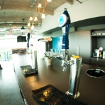 The kitchen/bar at Bigcommerce's Austin office