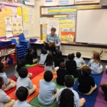Employees read to students in Denver once a month in support of TeleTech's Community Foundation.