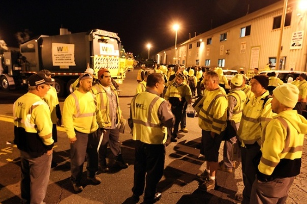 Drivers gather for a morning safety meeting. Safety is a core value with zero compromise at WM.