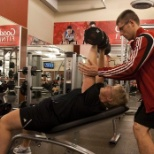 helping and correcting customers posture during workout