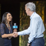 Salesforce Co-Founder Parker Harris awards a Salesforce employee at TrailheaDX in 2016.