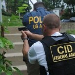 Military Police Criminal Investigation Special Agents perform raid