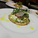Tostada. Con lobster. Y escamoles micro. Greens. And. Olive. Oil