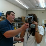 CTEH photo: Safety manager guides new employee on respirator fit training