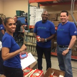 Employees helping out at Boca Helping Hands food pantry.