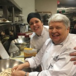 Atria on the Hudson resident and chef prepare a meal together.
