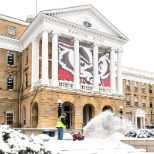 University of Wisconsin–Madison photo: UW grounds crew members work to clear snow from the steps and sidewalks in front of Bascom Hall.